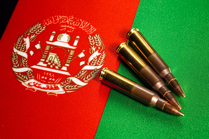 Three rifle cartridges on the flag of Afghanistan.