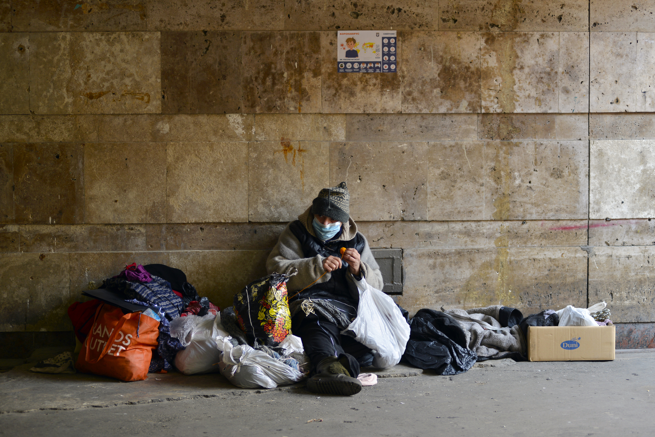 homeless woman in medical mask