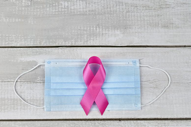 pink ribbon on hospital mask