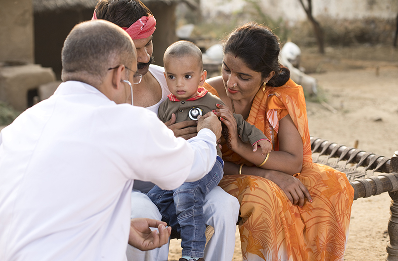 indian pediatrician with little boy