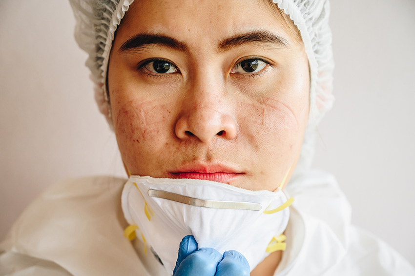 Asian masked healthcare worker