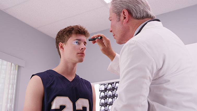 doctor looking at an athlete