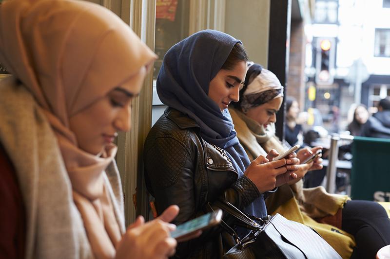 Muslim woman texting