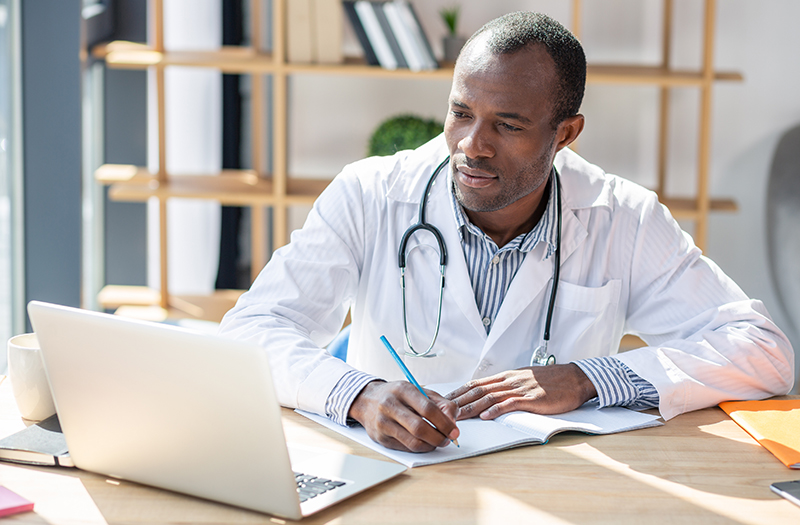 physician learning on a laptop