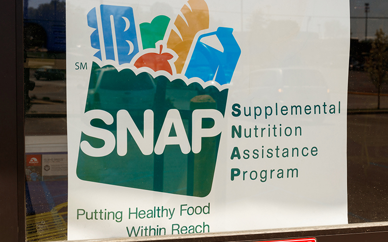 SNAP benefits sign in store window