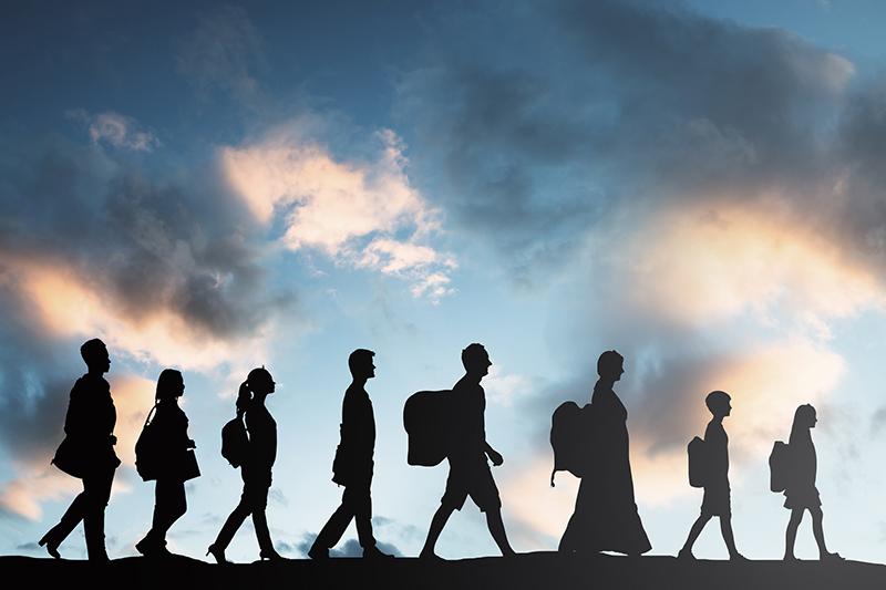 shadows of people walking with backpacks