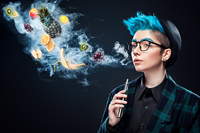 person with blue hair blowing fruit smoking from vape